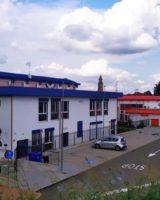 """Camposanto, Buonafede all'opera sulla facciata delle scuole medie per """"Quadricromie"""""""
